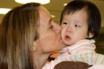 Mommy kissing a very overwhelmed littlegirl…