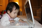 """Watching a favorite Korean """"Pororo"""" video the foster father loaded onto our USB drive. We were delighted to find that he also loaded many, many pictures and family videos of their time with Sarang. We are moved beyondwords."""