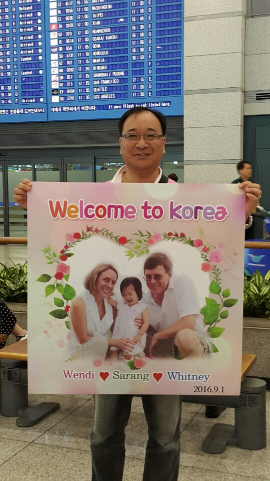 Appa with Large Welcome to Korea Sign