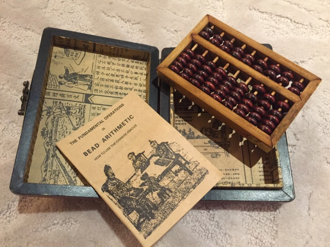 We found this traditional wooden Chinese abacus for Wen Jie on Shamian Island.
