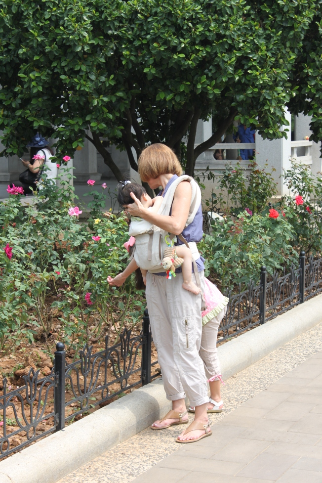 Mommy and Lily enjoying the rose garden. That's little Hope in Mommy's pouch.